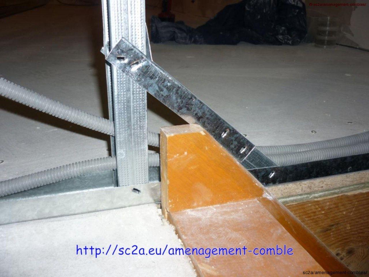 pose des montants et rails au niveau de l\'escalier 1