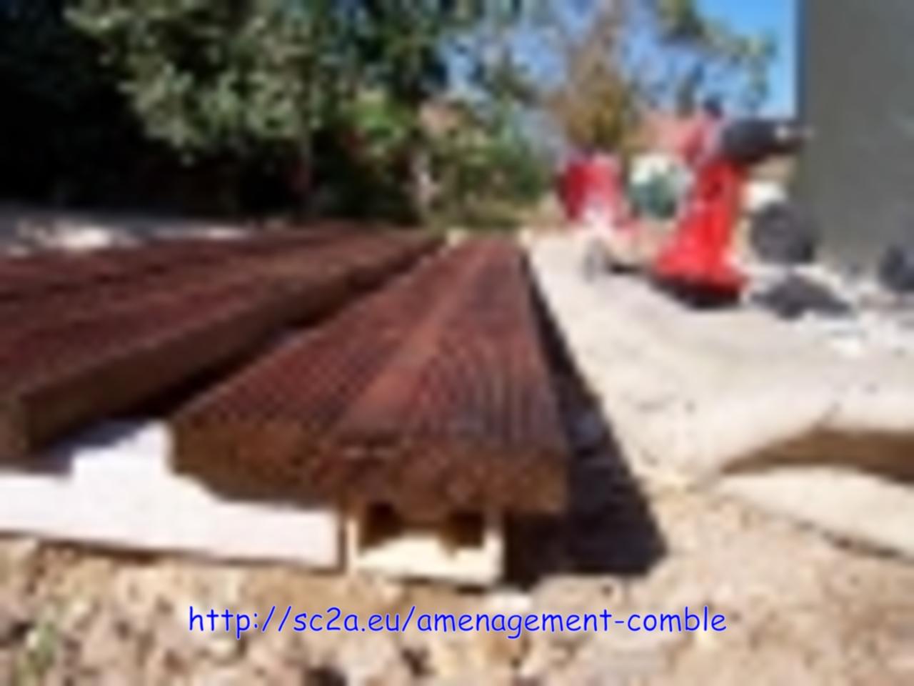 Pose au bord lames pin autoclave sur les lambourdes